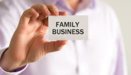 businessman-holding-card-text-family-business-closeup-businessman-holding-card-text-family-business-business-86583333 FAMILY BUSINESS