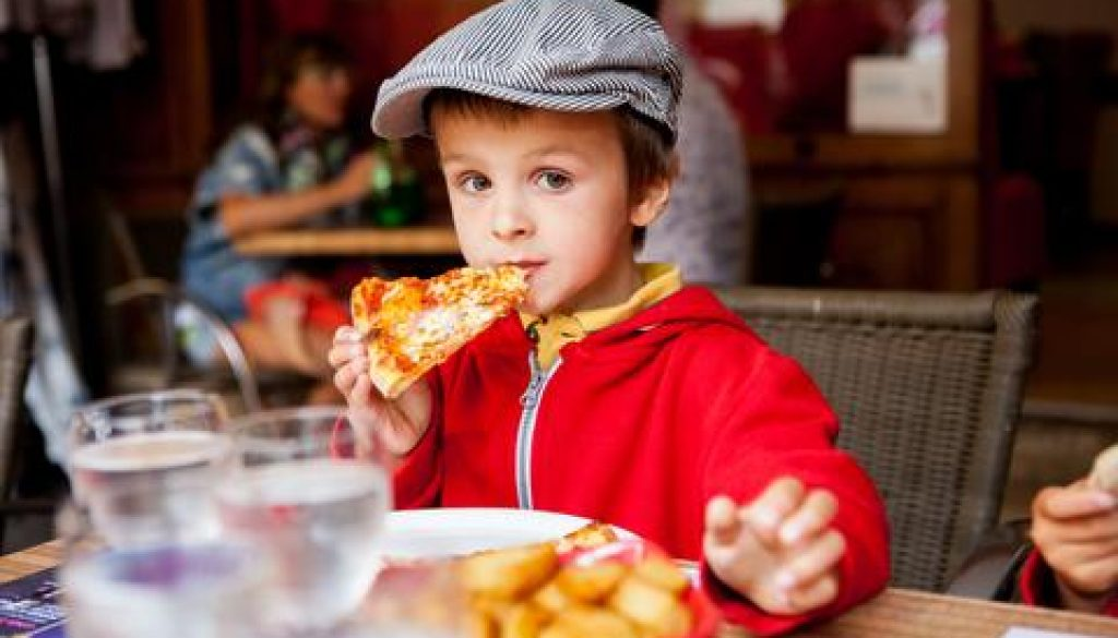 Pizza Restaurant with cute little boy